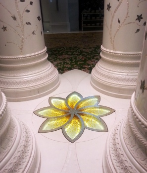 A close up of the star/flower design that adorns the Grand Mosque